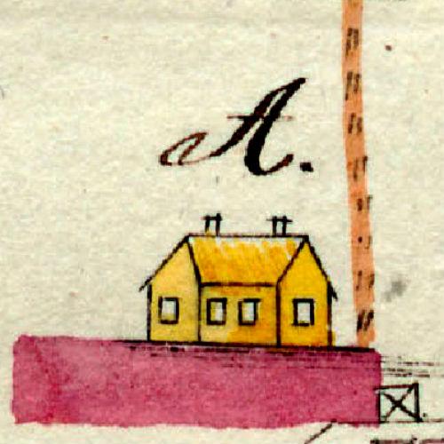 Keltaiseksi väritetty rakennus ja kaksi savupiipua. Tie rakennukselle tulee vanhaa reittiä mäen itäpuolelta .
